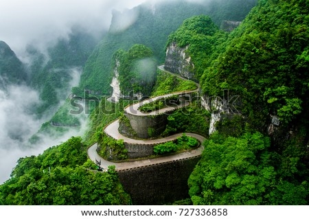 The winding road of Tianmen mountain national park (Zhangjiajie) in clouds mist, Hunan province, China #727336858