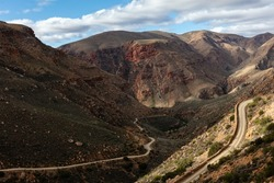 The winding road with hairpin bends of Swartberg pass near Prince Albert, South Africa