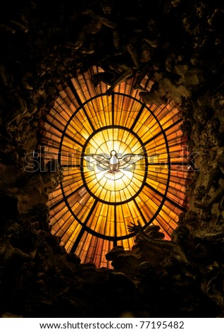 The window of a cathedral of St. Peter in Vatican, with a dove representing the holy spirit.