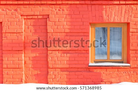 the window on the wall of red...