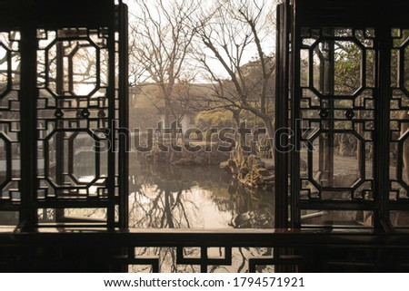 The window view at Humble Administrator Garden(Zhuozheng Garden) in early morning.Zhuozheng Garden a classical garden,in UNESCO World Heritage Site and is the most famous of the gardens of Suzhou. Stock fotó ©