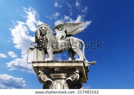 The winged lion of St Mark, symbol of the Venetian Republic, in Piazza delle Erbe, Verona (UNESCO world heritage site), Veneto, Italy  #217483162