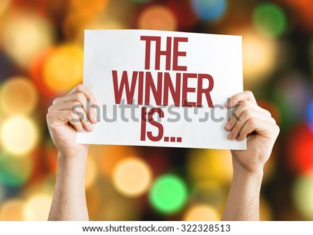 The Winner Is... placard with bokeh background