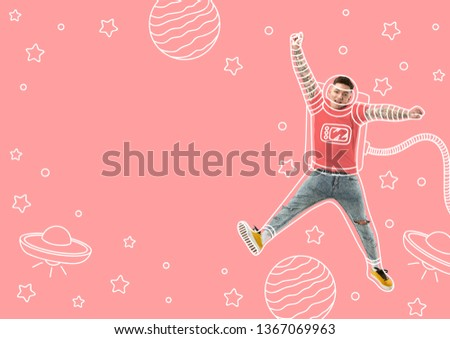The winner of the space battles. Dreaming about cosmonaut profession or travel the cosmos. Man in drawing imaginary spacesuit against trendy coral background. Copyspace to insert your text.