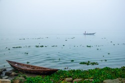 The winter morning in the riverbank with traditional boat. Image captured from Chandpur, Bangladesh, Asia