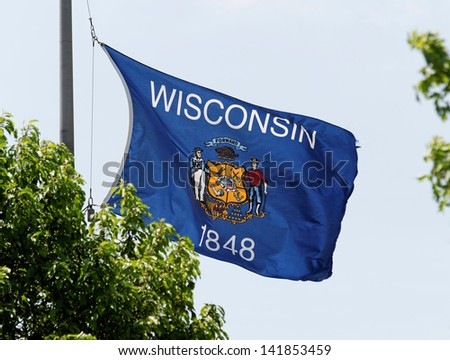 The Wisconsin state flag waving in the wind.