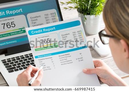 The woman checks the credit report and how many credit points.