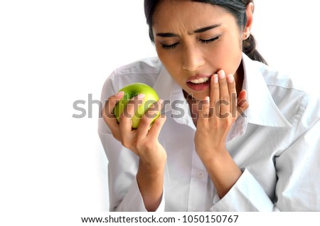 The woman had a toothache after biting apple. Should take care of your gum and teeth.