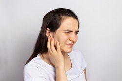 The woman has a sore ear - infection, inflammation from infection and otitis. Perforation ruptured the eardrum. Arthritis of the temporal lower jaw joint, osteoarthritis and pain in the jaw