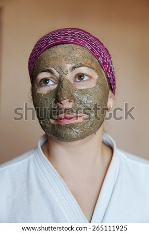 The woman in a cosmetic clay mask