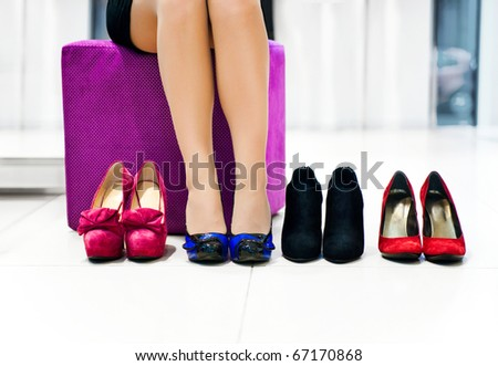 The woman in shop chooses shoes