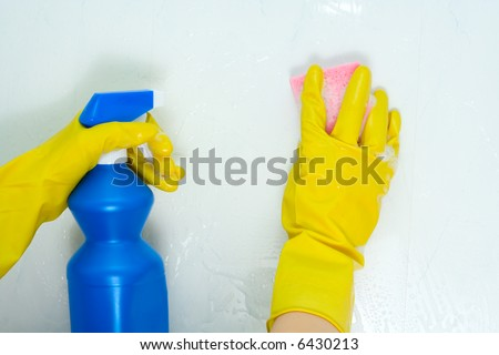 The woman is engaged in cleaning in the house - stock photo