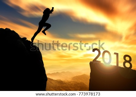The woman jumping from 2017 cliff to 2018 cliff on sunrise time : meaning to going to year 2018 #773978173
