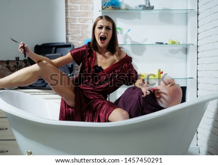 The woman killer. Killer lover. Wife killed husband. Criminals or murderers with a knife in the blood. Dead body lying on the bath. Crime scene
