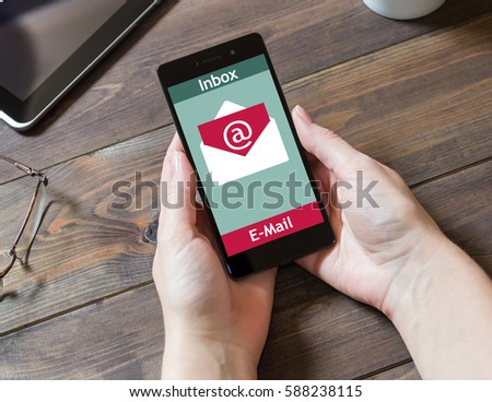 The woman received an e-mail online on a mobile phone. Message online icon. #588238115