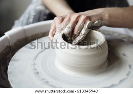 The woman's hands close up, the masterful studio of ceramics works with clay on a potter's wheel Сток-фото ©