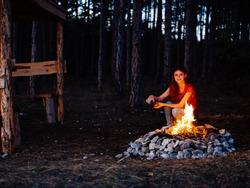 the woman scattered a bonfire in the open air