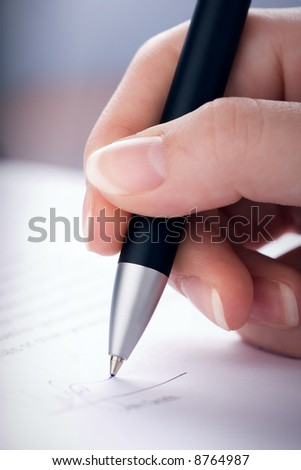 The woman signs the contract a ball pen
