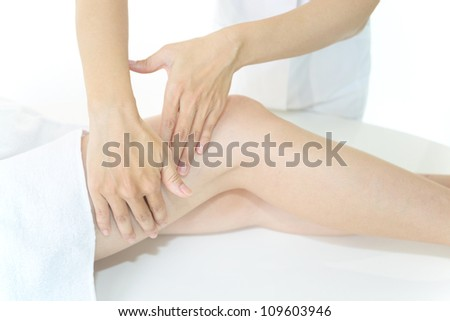 The woman who receives foot massage