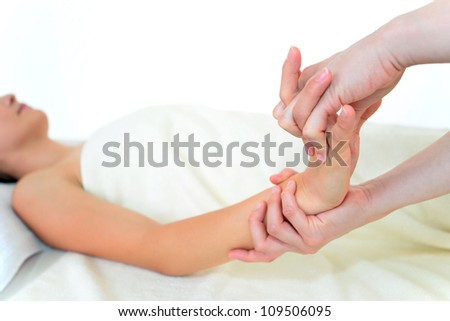 The woman who receives hand massage