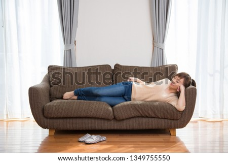 The woman who sits down on a sofa #1349755550