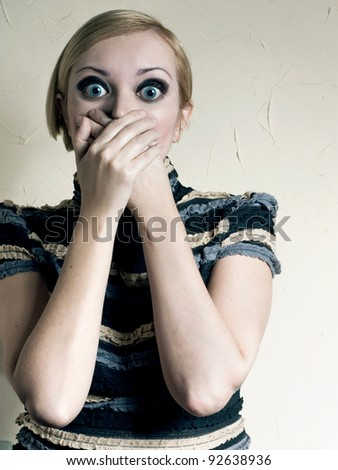 The woman with huge eyes for fear - stock photo