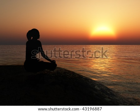 The women in a pose of a lotus. A sunset above ocean