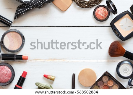 The women's cosmetics set on a background of white wooden table, modern woman.