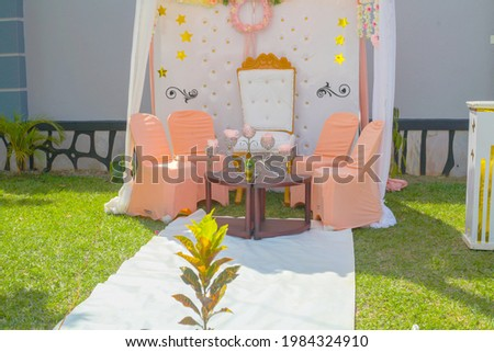 The wonderful birthday party decoration of the chairs and the flowers on that special day for that special some one  Сток-фото ©