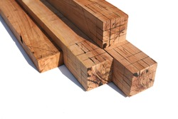 The wood sawn into a cuboid with black lines drawn on it