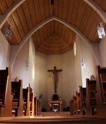 the wooden church with cross on the wall