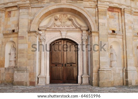 The wooden door of the monastery of the Holy Cross in Poland