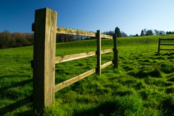 The wooden fence in rural Parbold, England on a beautiful spring day.