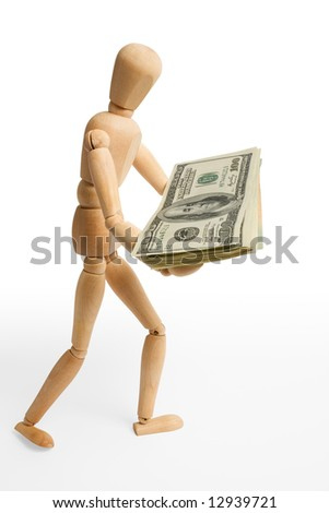 The wooden figure holds dollars.Isolated on white [with clipping path].