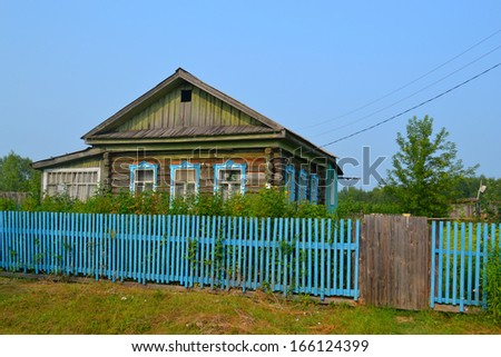 The wooden house in the village in the summer.