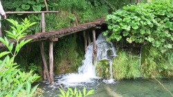 the wooden park pathways enjoying the view of emerald lakes, cascades and crystal clear water, Plitvice Lakes National Park, Croatia