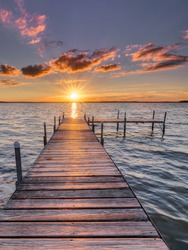 the wooden pier at sunset