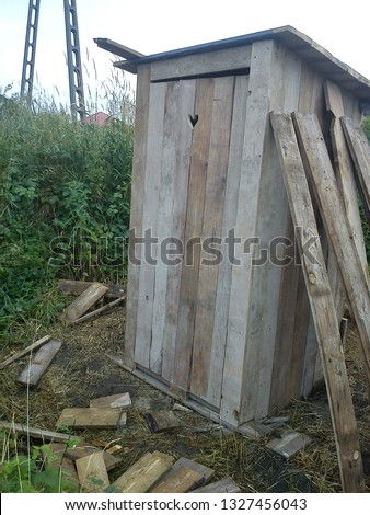 The wooden privy with a hole in a shape of the heart in the door
