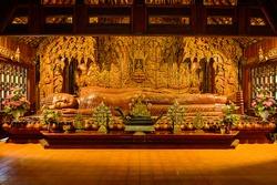The Wooden Reclining Buddha of Wat Luang Khun Win in Chiangmai Province, Thailand.