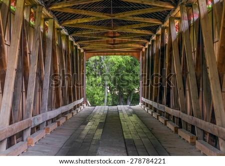 The wooden trusses of the James Covered Bridge are seen from within. The historic bridge crosses Big Graham Creek in rural Jennings County, Indiana.