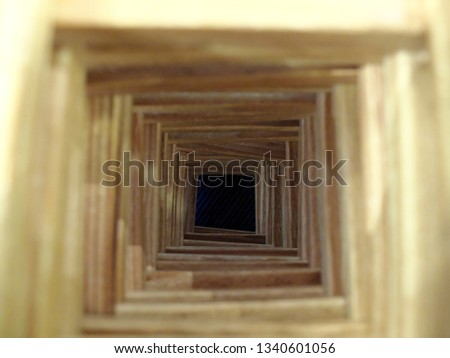 The wooden tunnel to the dark abyss. The concepts of loosing hope, hopeless future, misfortune and mistakes. Selective focus on the bottom.