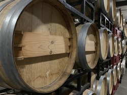 The wooden wine barrels in a winer