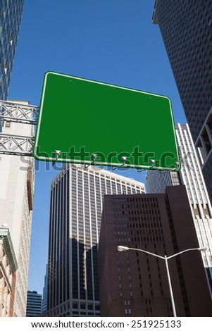 The word a new you and green billboard sign against new york