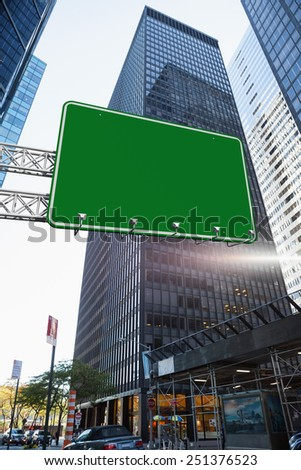 The word a new you and green billboard sign against skyscraper in city