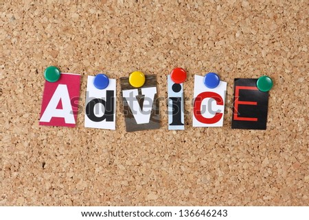 The word Advice in cut out magazine letters pinned to a cork notice board
