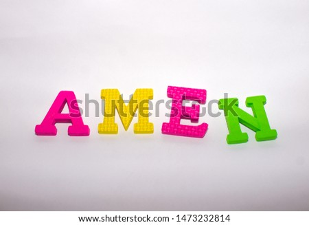 """The word """"Amen"""", made from bright puzzles"""