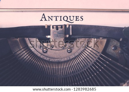 The word Antiques typed typewriter. #1283982685