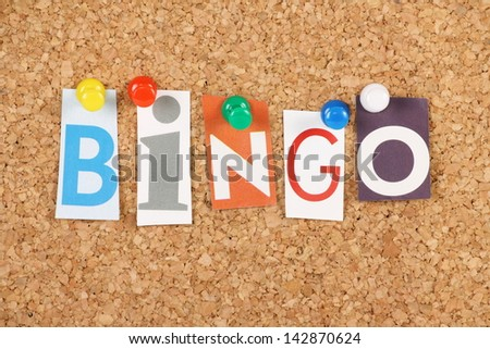 The word Bingo in cut out magazine letters pinned to a cork notice board. Bingo is a gambling game and the word is used to announce a full house or for someone providing a solution or answer