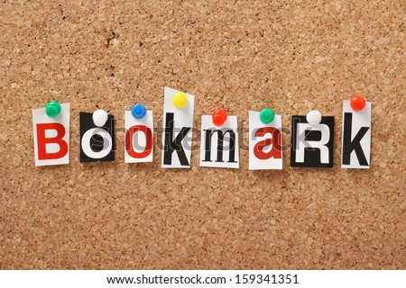 The word Bookmark in cut out magazine letters pinned to a cork notice board.