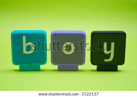 The word 'boy' spelt in letters isolated on green
